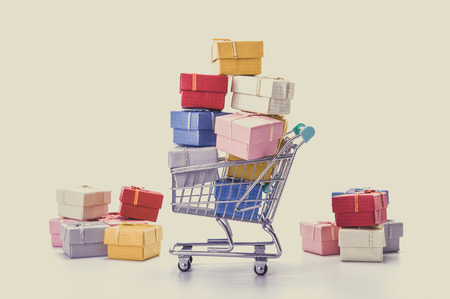 shopping baskets: colorful gifts box,supermarket shopping cart
