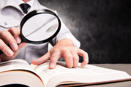 difficult to find: magnifying glass Stock Photo