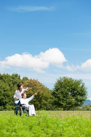 Senior riding in a wheelchair in the park Reklamní fotografie
