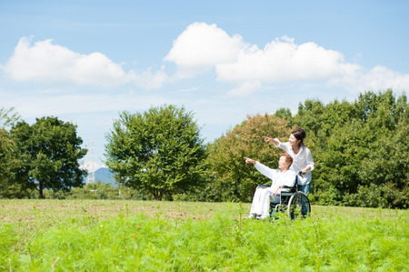 Senior riding in a wheelchair in the park