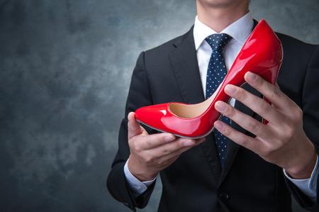 berserk: Businessman to have a red high heels