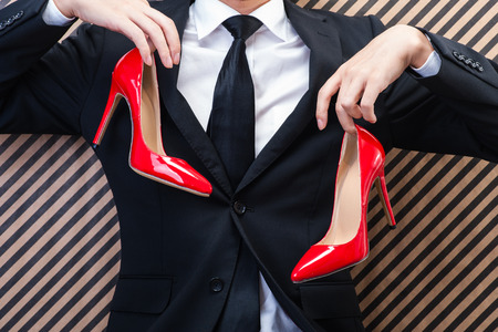 sm: Businessman to have a red high heels