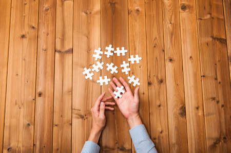 White jigsaw puzzle on the plate