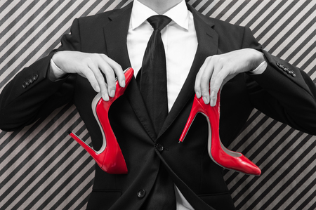 worried businessman: Businessman to have a red high heels