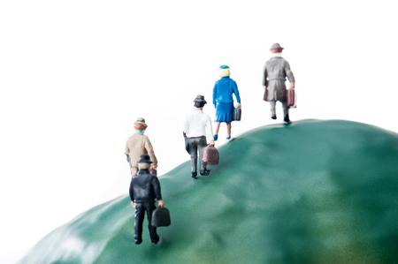 Businessman walking the steep mountain