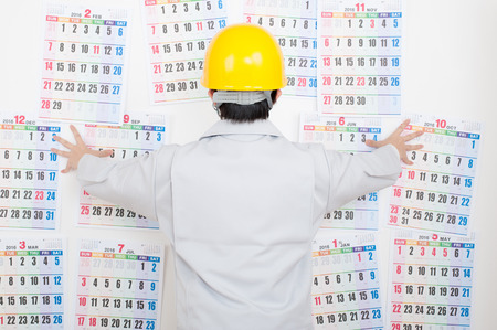 Los hombres de la ropa de trabajo, calendario Foto de archivo