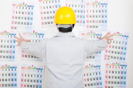 Men of werkkleding, kalender Stockfoto