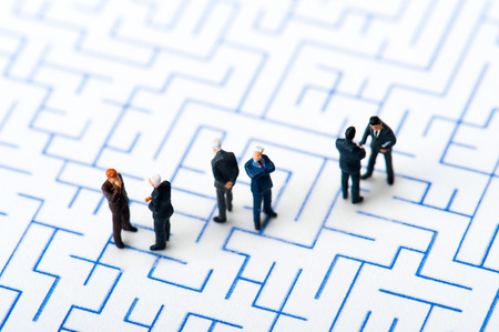 insider trading: Maze and businessmen, miniature,