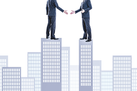 Handshake between businessman Stock Photo