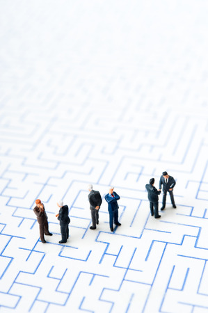illegal trading: Maze and businessmen, miniature,