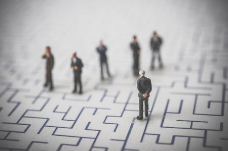 debt management: Maze and businessmen, miniature,