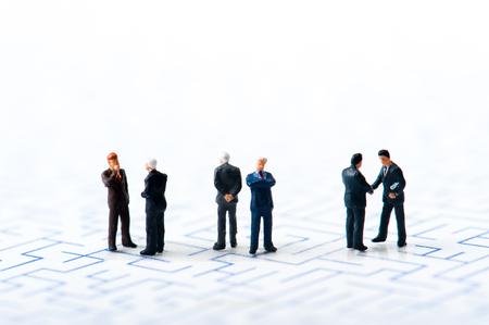 debt goals: Maze and businessmen, miniature,