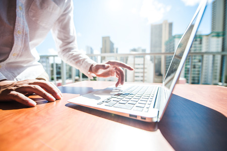 Businessman are using a laptop at the window Stock Photo - 53448056
