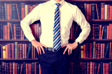 a lot: Businessman standing in front of a lot of books
