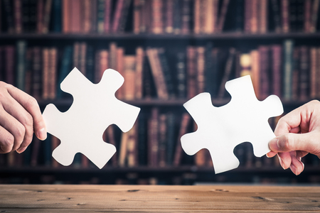 human beings: The hands of human beings to have a jigsaw puzzle piece