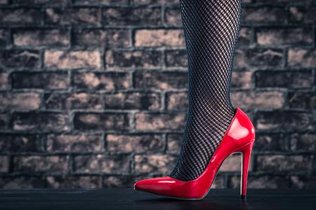 fishnet tights: High heeled women