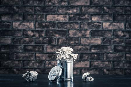 The trash,brick background