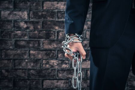 iron chain: Iron chain, Man wearing a suit Stock Photo