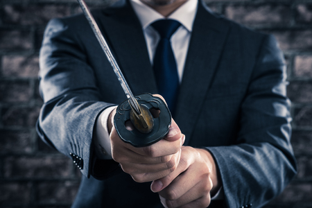 seriously: Businessman and japanese sword Stock Photo