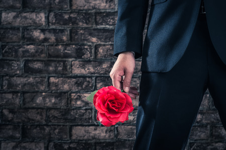 adultery: Man wearing a suit to have the roses Stock Photo