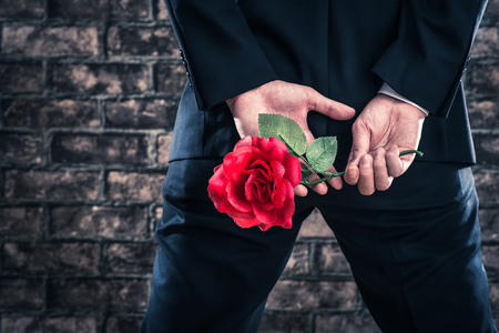 Man wearing a suit to have the roses Stock Photo