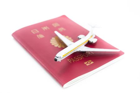 飛行機とパスポート 写真素材