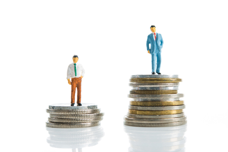 Miniature, man standing on top of the money