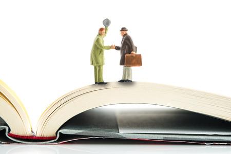 of miniature: Handshake, miniature, Books Stock Photo