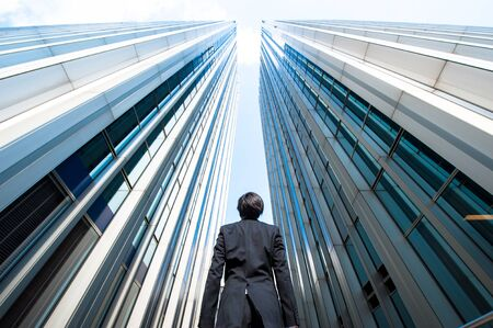 low angle: Businessman looking up at the high building, low angle Stock Photo