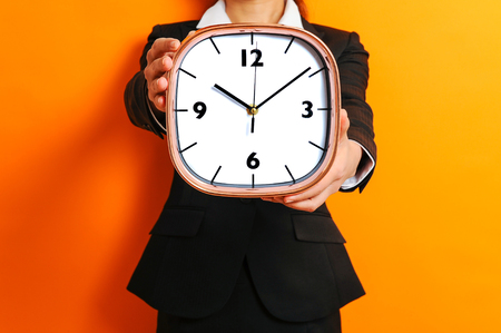 overslept: Business woman and alarm clock