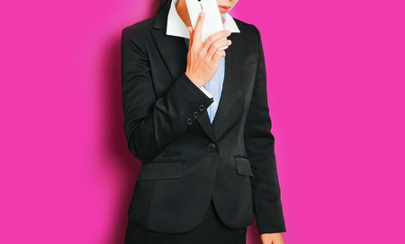 instability: Businesswoman to operate the smart phone, pink background