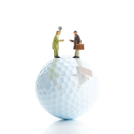 Golf balls and businessman