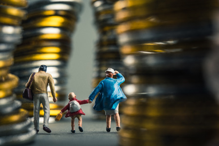family walking on the road, surrounded by money Stock Photo