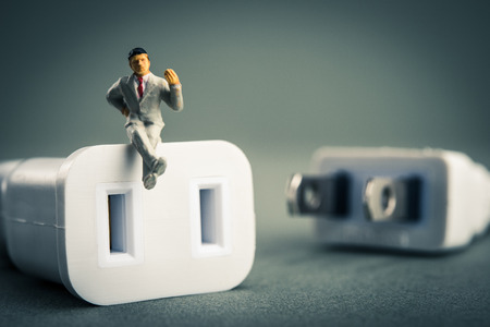 outage power: Power cord and businessman Stock Photo