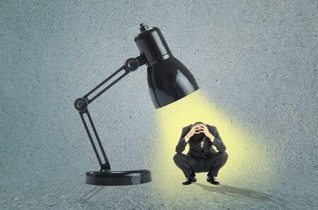 confide: Businessman and spotlight