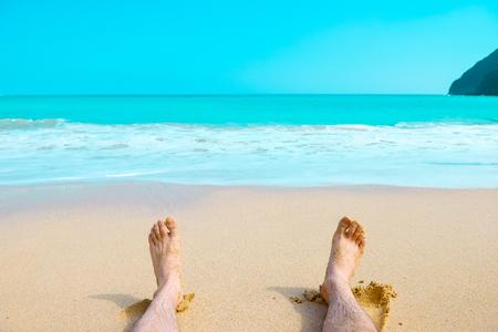 Sandstrand und Füße
