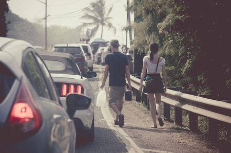 roadway: Couples walk the roadway