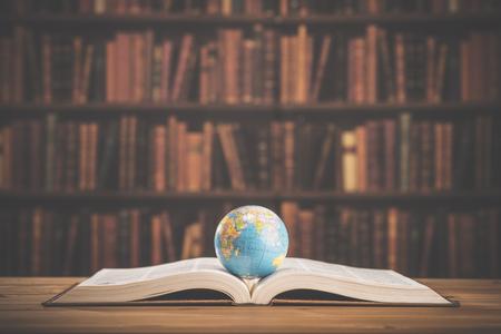 business globe: Heavy book and globe Stock Photo