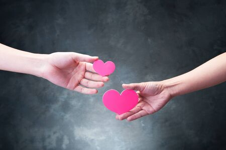 beings: The hands of human beings who have a red heart Stock Photo