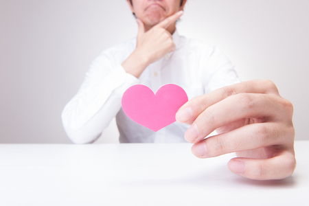 human beings: The hands of human beings who have a red heart Stock Photo