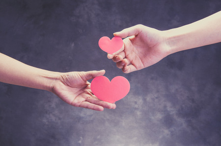 The hands of human beings who have a red heart Stock Photo