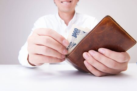 caching: Wallet and men Stock Photo