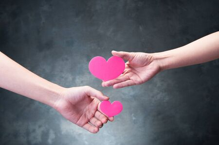matchmaking: The hands of human beings who have a red heart Stock Photo