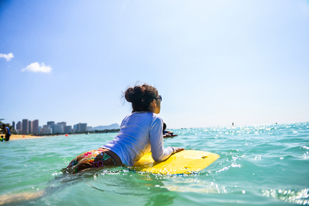 Women who have a body board in the sea