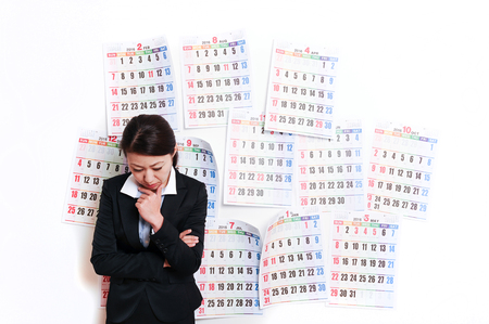 restructuring: Businesswoman suffering in front of the calendar Stock Photo
