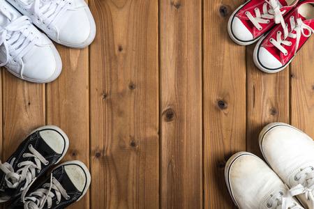 Family of sneakers, woodgrain Stock Photo