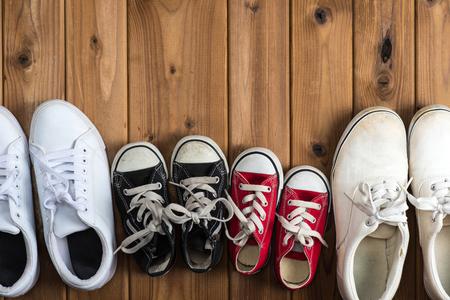 woodgrain: Family of sneakers, woodgrain Stock Photo