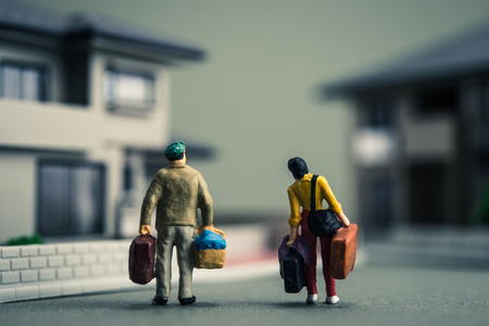 家族と住宅のミニチュア 写真素材