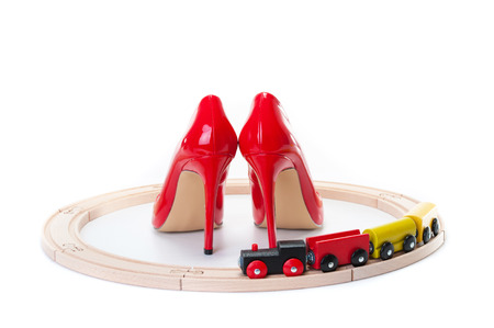 Red high heels and a toy locomotive