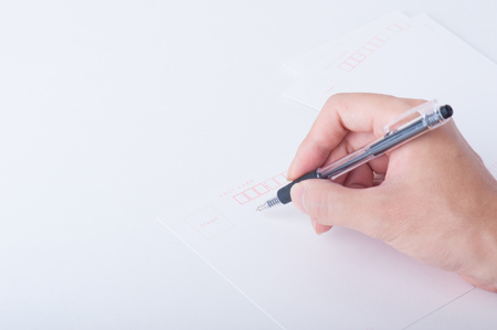 person writing: The hand of the person writing the letter Stock Photo